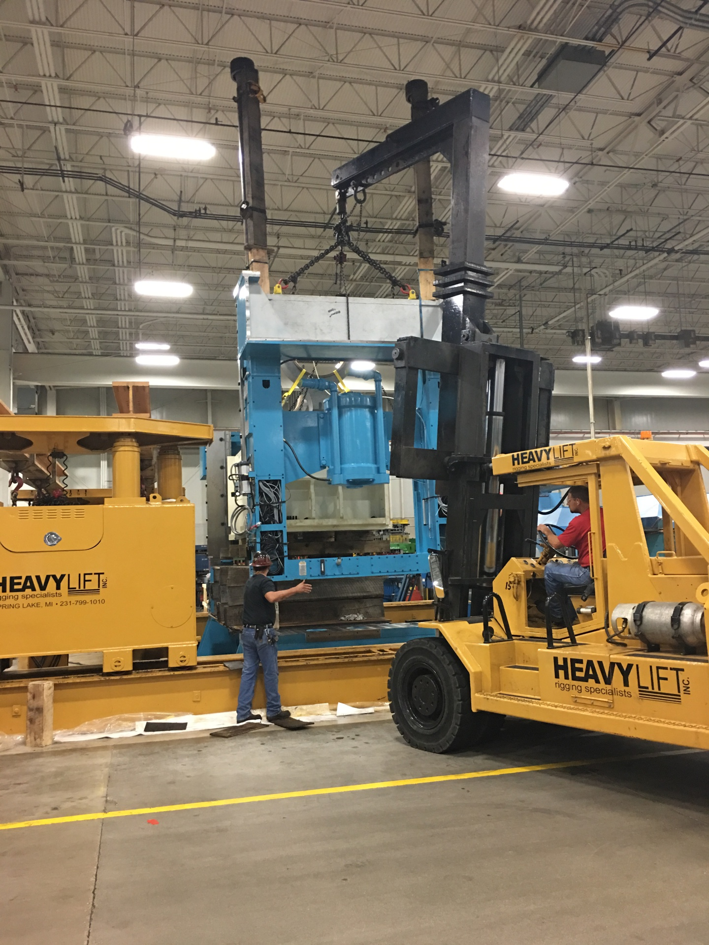 Installing side frame and tie bars on 800-ton Minster Press.